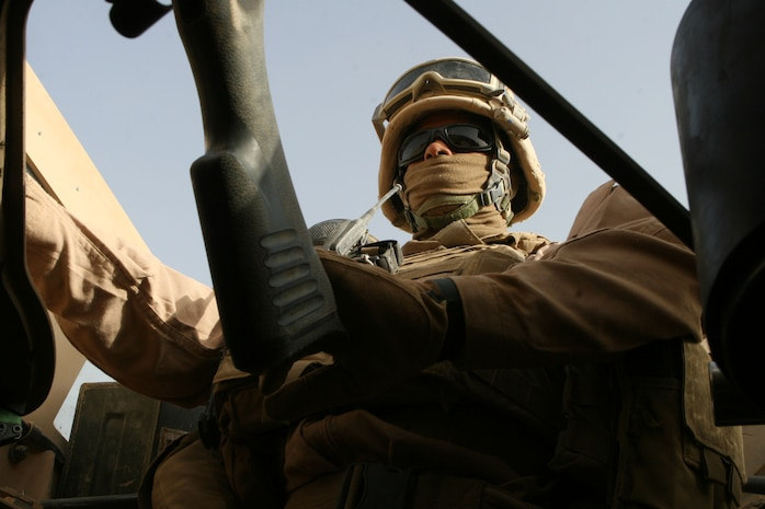 Cpl. Antwan N. Stewart, a heavy equipment mechanic for Alpha Company, 2nd Combat Engineer Battalion, takes the machine gunner position during a supply convoy, Nov. 22. The supply convoy brought needed supplies to forward operating bases Geronimo and Delhi. 2nd Battalion, 2nd Marine Regiment, occupies FOB Delhi conducting counterinsurgency operations.