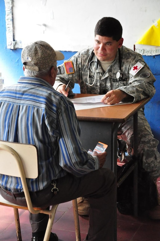 ILOPANGO, El Salvador – Army Dr. (Lt. Col.) Bart Diaz, Joint Task Force-Bravo flight surgeon, speaks with an elderly gentleman about his medical problems Nov. 20 in San Diego, El Salvador. JTF-Bravo Medical Element performed a Medical Civil Action Program, or MEDCAP, from Nov. 19 to 23 treating 2,987 people in several different cities affected by the El Salvador mudslides. (U.S. Air Force photo/Staff Sgt. Chad Thompson).