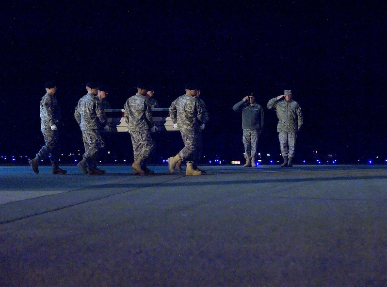 A U.S. Army carry team transfers the remains of Army Specialist Daniel A. Frazier., of Saint Joseph, Mich., at Dover Air Force Base, Del., Nov. 21, 2009. Specialist Frazier was assigned to Company E, 782nd Brigade Support Bat, Fort Bragg, NC. (U.S. Air Force photo by Brianne Zimny)
