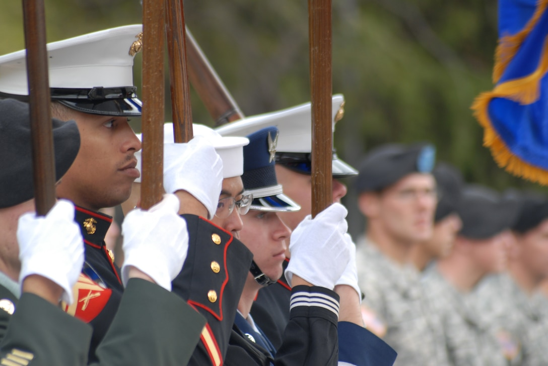 The Goodfellow Joint Service Color Guard and formations of Soldiers, Sailors, Airmen and Marines from Goodfellow AFB, Texas, form up after participating in the annual Hunt for Heroes parade through San Angleo on Nov. 20.  25 wounded veterans took part in the annual Hunt for Heroes event in West Texas, hosted by the Show of Support Military Hunt Inc., a nonprofit organization.  The criteria for the hunt are the veterans have to be wounded or disfigured and discharged from the military. (U.S. Air Force photo/Robert D. Martinez)