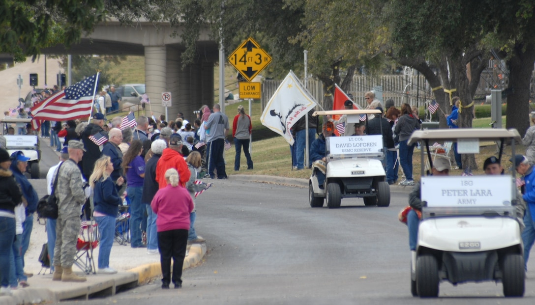 Wounded warriors are driven in golf carts by Soldiers, Sailors, Airmen and Marines from Goodfellow AFB, Texas in a Hunt for Heroes parade through San Angleo on Nov. 20.  25 wounded veterans took part in the annual Hunt for Heroes event in West Texas, hosted by the Show of Support Military Hunt Inc., a nonprofit organization.  The criteria for the hunt are the veterans have to be wounded or disfigured and discharged from the military. (U.S. Air Force photo/Robert D. Martinez)