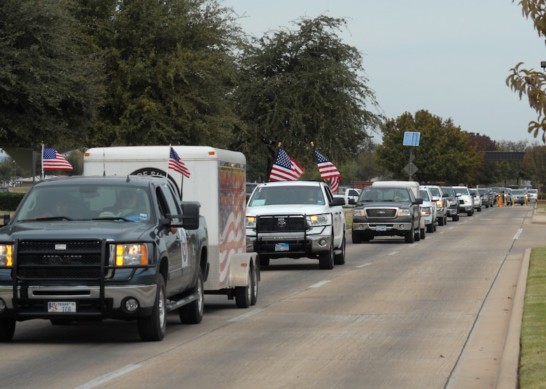 A caravan of vehicles with wounded veterans aboard arrive at Goodfellow AFB, Texas on Nov. 20.  25 wounded veterans took part in the annual Hunt for Heroes event in West Texas, hosted by the Show of Support Military Hunt Inc., a nonprofit organization.  The criteria for the hunt are the veterans have to be wounded or disfigured and discharged from the military. (U.S. Air Force photo/Robert D. Martinez)