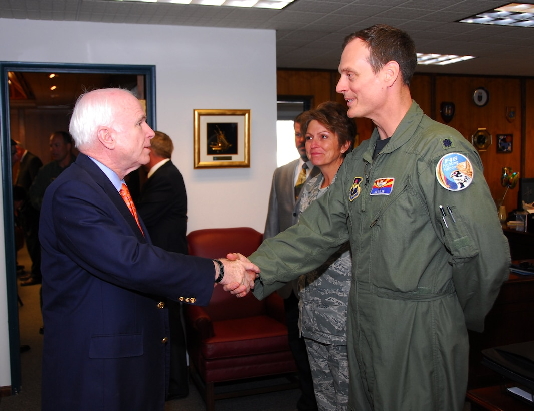 U.S. Senator John McCain greets Lt. Col. James Taylor, 162nd Fighter Wing Maintenance Group commander, and Col. Karen Bence, Mission Support Group commander, Nov. 24 at the Arizona Air National Guard base at Tucson International Airport.  Senator McCain visited to show support for the wing and its future.  (U.S Air Force photo by Master Sgt. David Neve)