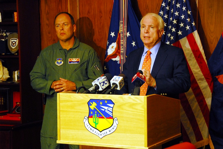 U.S. Senator John McCain and Col. Greg Stroud, 162nd Fighter Wing commander, answer questions during  a news conference Nov. 24 at the Arizona Air National Guard base at Tucson International Airport. Senator McCain visited to show support for the wing and its future.  (U.S Air Force photo by Master Sgt. David Neve)