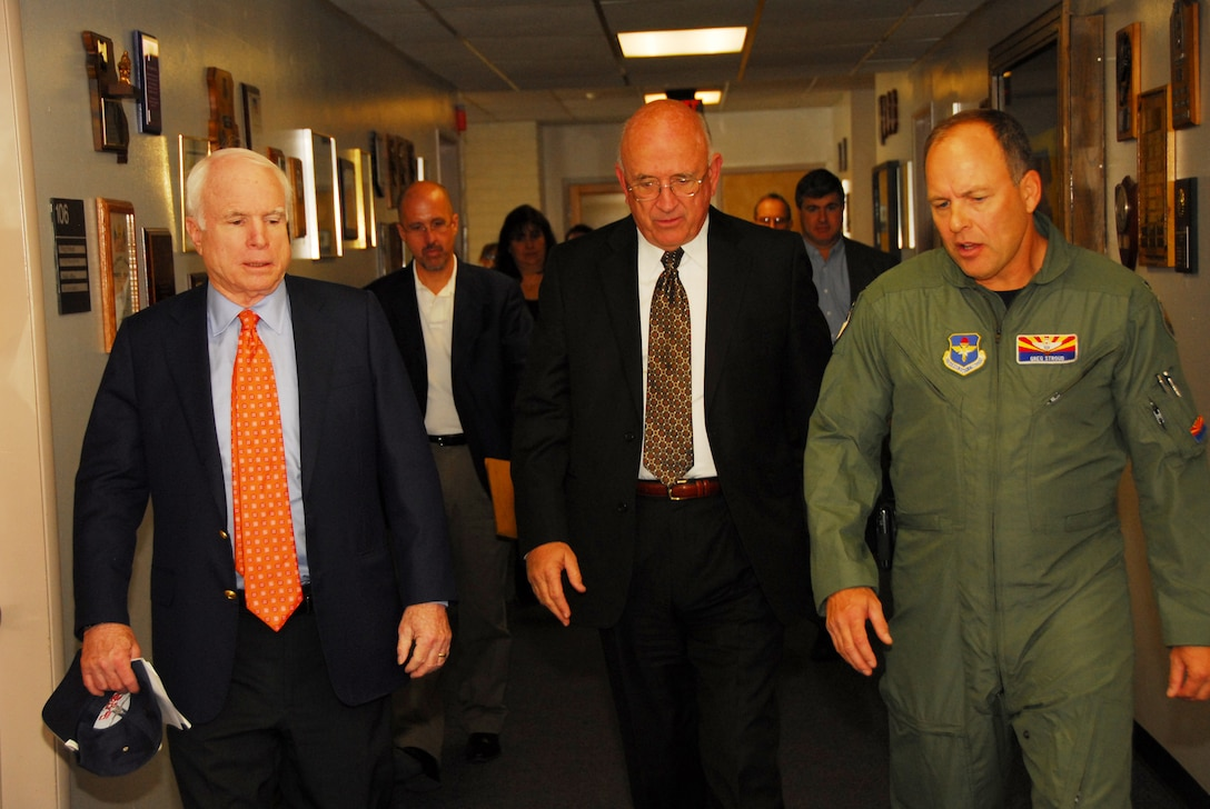 U.S. Senator John McCain, Tucson Mayor Bob Walkup, and Col. Greg Stroud, 162nd Fighter Wing commander, head to a news conference Nov. 24 at the Arizona Air National Guard base at Tucson International Airport.  Senator McCain visited to show support for the wing and its future.  (U.S Air Force photo by Master Sgt. David Neve)
