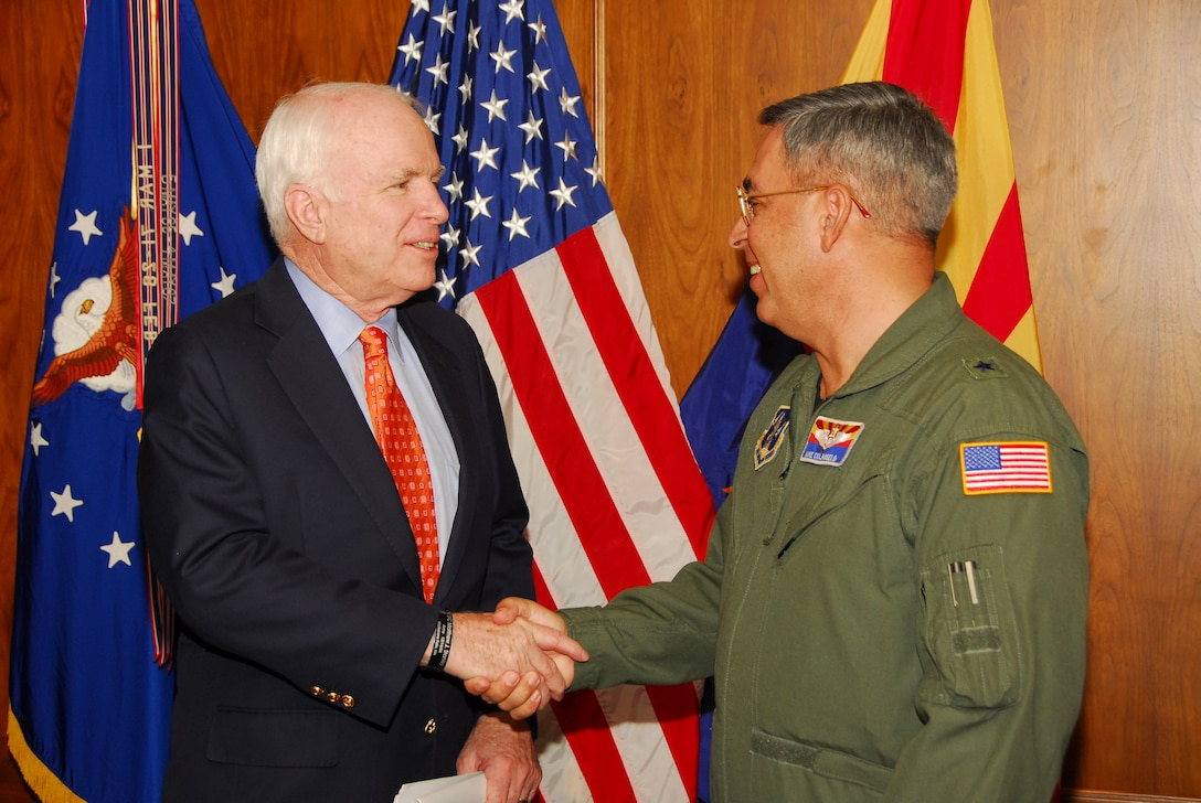 U.S. Senator John McCain greets Brig. Gen. Michael Colangelo, Arizona Air National Guard commander, Nov. 24 at the 162nd Fighter Wing at Tucson International Airport. Senator McCain visited to show support for the wing and its future.  (U.S Air Force photo by Master Sgt. David Neve)