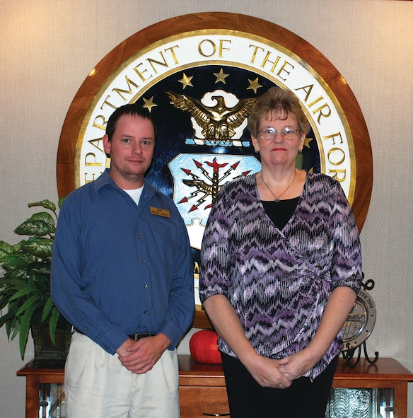 "OFFUTT AIR FORCE BASE, Neb. - Kjell Flatoen, acting Patriot Club manager (left) and Cathy L. Francis, the wife of retired Master Sgt. Mitchell J. Francis (right), pose for a photo at the Patriot Club shortly after Mrs. Francis was notified that her essay, ""The High Cost of Freedom,"" was one of 25 winning essays selected in the Air Force's 2009 Membership Scholarship Program essay contest. The contest awarded 25 $1,000 scholarships to Air Force family club members. U.S. Air Force Courtesy Photo"