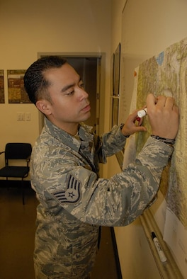 Staff Sgt. Emanuel Matsamura, 129th Operation Support Flight NCOIC of intelligence training, is this month's Portrait of a Professional. (Air National Guard photo by Staff Sgt. Kim Ramirez)
