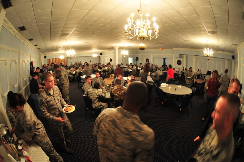 Airmen from the 4th Fighter Wing gather in the consolidated club ball room to enjoy a Chief's Pancake Breakfast on Seymour Johnson Air Force Base, N.C., Nov. 20, 2009. The Chief's Group served more than 700 Airmen during breakfast. The money raised will go toward events for the enlisted Airmen stationed on Seymour Johnson. (U.S. Air Force photo/Airman 1st Class Rae Perry)