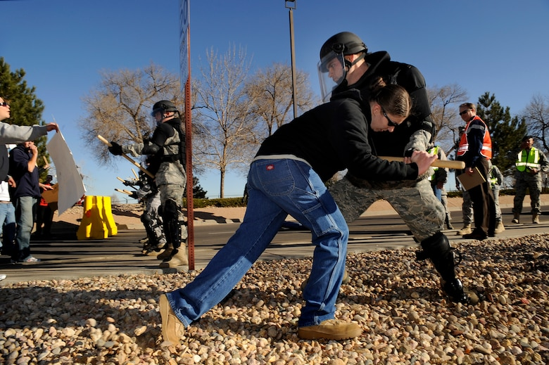 BUCKLEY AIR FORCE BASE, Colo. -- Staff Sgt. Kaitlan Manning, 566th Intelegence Squadron, tries to break through the Confrontation Management Team's barrier during an exercise Nov. 24. (U.S. Air Force photo by Staff Sergeant Steve Czyz)