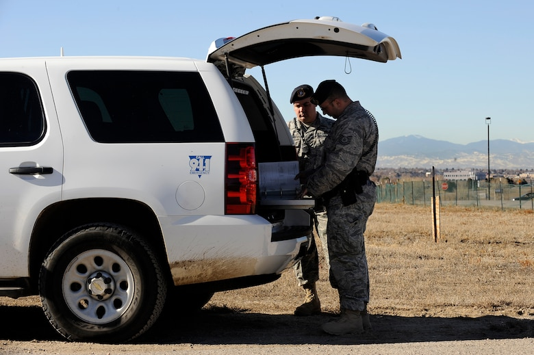 BUCKLEY AIR FORCE BASE, Colo. -- Two members of the 460th Security Forces Squadron go over cordon procedures during the base-wide exercise Nov. 24. (U.S. Air Force photo by Staff Sergeant Steve Czyz)