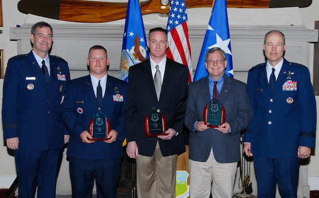 Air Education and Training Command Educator of the Year 2008-2009 awards were presented Nov. 16 at Maxwell's Officers Club by AETC Commander Gen. Stephen Lorenz (far left). Receiving the awards (from left) are Tech. Sgt. Jonathan Mathe in the enlisted category, Capt. Michael Batchelor in the officer category and Dr. Richard Muller in the civilian category. Also shown is Lt. Gen. Allen G. Peck, commander of Air University. (U.S. Air Force photo/Bud Hancock)