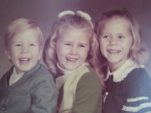 """This photo was taken sometime in 1970, about a year before my father died in a car accident. This was the last time we had a """"formal"""" family photo taken as children. The changes his death wrought included the exclusion of family photos. Neither money nor my mother's work schedule allowed for another family photo. Years later, as young adults, my sisters and brother and I surprised our mother with a current family photo. I'm in the middle, approximately 4 years old. (Courtesy photo)"""