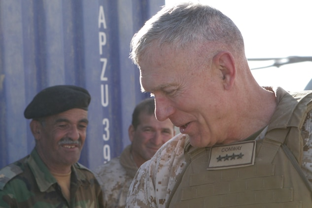 Gen. James T. Conway, the commandant of the Marine Corps, greets the Marines of 2nd Battalion, 2nd Marine Regiment, during his visit to Forward Observation Base Delhi, in Garmsir, Afghanistan, Nov. 26, 2009. The commandant and Sgt. Maj. Carlton W. Kent, the sergeant major of the Marine Corps visited the Marines of 2/2 to talk about current changes and issues throughout the Marine Corps.
