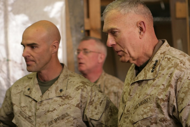 Gen. James T. Conway, the commandant of the Marine Corps, is shown a map of 2nd Battalion, 2nd Marine Regiment?s area of operation by Lt. Col. John E. McDonough, the commanding officer of 2/2, during his visit at Forward Operating Base Delhi, in Helmand province, Afghanistan, Nov. 26, 2009. The commandant and Sgt. Maj. Carlton W. Kent, the sergeant major of the Marine Corps, visited the Marines of 2/2 to talk about current changes and issues throughout the Marine Corps.