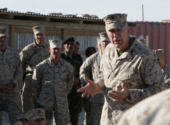 Gen. James T. Conway, the commandant of the Marine Corps, talks to the Marines of 2nd Battalion, 2nd Marine Regiment, during his visit to Forward Operating Base Delhi, in Helmand province, Afghanistan, Nov. 26, 2009. The commandant and Sgt. Maj. Carlton W. Kent, the sergeant major of the Marine Corps visited the Marines of 2/2 to talk about current changes and issues throughout the Marine Corps.