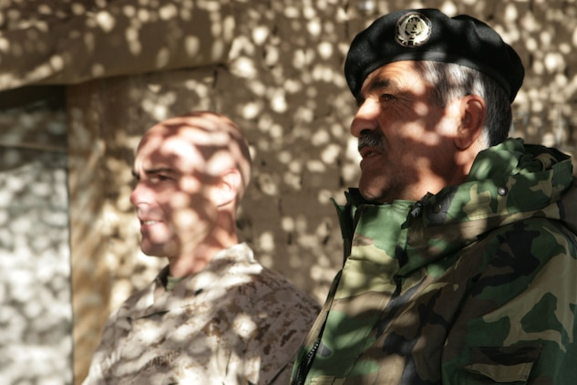 Lt. Col. John E. McDonough, commanding officer of 2nd Battalion, 2nd Marine Regiment, and Maj. Noor Mohammad, the executive officer of 6th Battalion, 3rd Brigade, 205th Corps, Afghan National Army, sit together before a graduation ceremony on Patrol Base Shamshad, Nov. 26, 2009. Twenty-eight members of 6th Battalion graduated after two weeks of training headed by soldiers from 2nd Battalion, 508th Parachute Infantry Regiment, 4th Brigade Combat Team, 82nd Airborne Division.