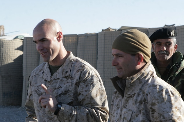 Lt. Col. John E. McDonough, left, the commanding officer of 2nd Battalion, 2nd Marine Regiment, and his interpreter, Ray, talk to members of the 6th Battalion, 3rd Brigade, 205th Corps, Afghan National Army, after their graduation ceremony at Patrol Base Shamshad, Nov. 26, 2009. Twenty-eight members of 6th Battalion graduated after two weeks of training headed by soldiers from 2nd Battalion, 508th Parachute Infantry Regiment, 4th Brigade Combat Team, 82nd Airborne Division.