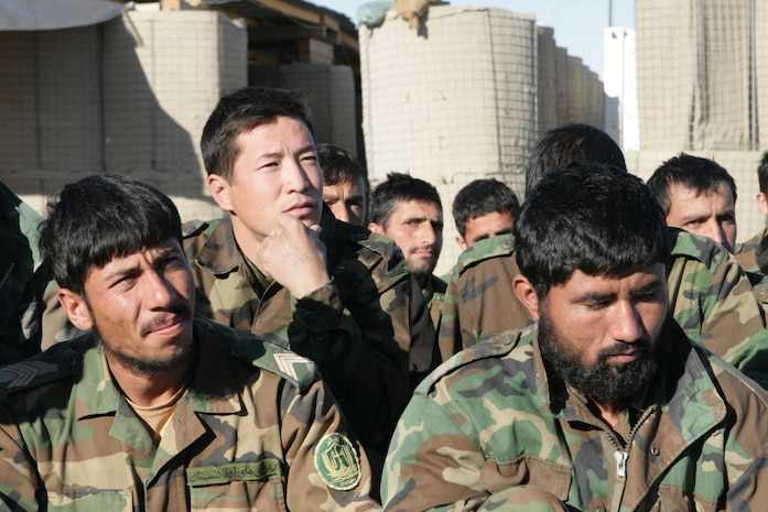 Members of the 6th Battalion, 3rd Brigade, 205th Corps, Afghan National Army, listen to a speech by Lt. Col. John E. McDonough, the commanding officer of 2nd Battalion, 2nd Marine Regiment, after their graduation ceremony at Patrol Base Shamshad, Nov. 26, 2009. Twenty-eight members of 6th Battalion graduated after two weeks of training headed by soldiers from 2nd Battalion, 508th Parachute Infantry Regiment, 4th Brigade Combat Team, 82nd Airborne Division.