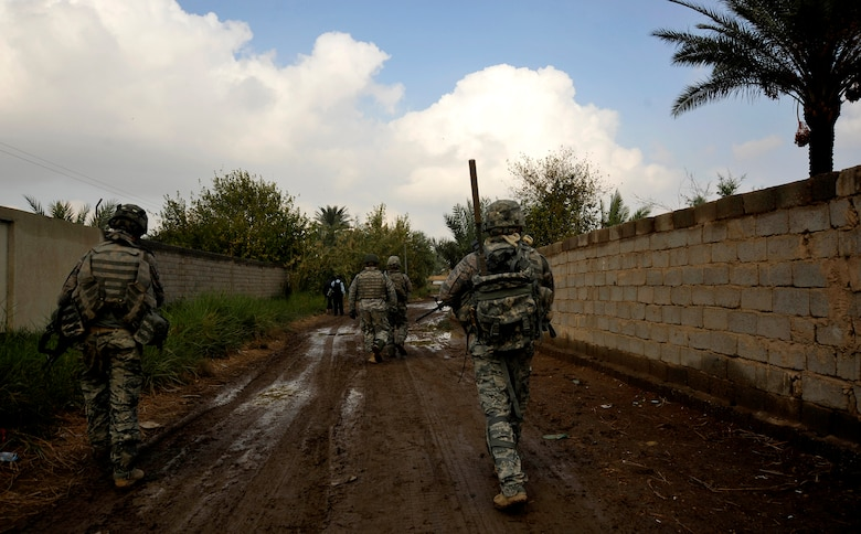 U.S. Air Force Defenders from the 732nd Expeditionary Security Forces Squadron Det. 2, deployed to Baghdad, Iraq, conduct a foot patrol through a Baghdad neighborhood in an effort to assess local checkpoints set up by the Iraqi Police, Nov. 19, 2009. (U.S. Air Force photo/Staff Sgt. Angelita Lawrence)
