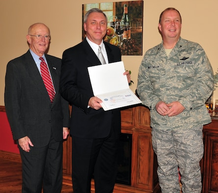 NIAGARA FALLS AIR RESERVE STATION, N.Y. -- Local employers received the Patriot Award at a commander's luncheon and ceremony here November 12, 2009.  Mr. Dennis Dragich, Niagara County Community College, receives the Patriot Award from Mr. Fred Dentinger, Western New York Employer Support of the Guard and Reserve (ESGR), and Col. Allan Swartzmiller, 914th Airlift Wing commander.  Air Force Reservists or members of their families may nominate employers for recognition for their exceptional support of employees who are Air Force Reservists.  Nominations were submitted to the ESGR, and ESGR's local committee selected the awardees.  This award is presented to employers for exceeding the requirements of the Uniformed Services Employment and Reemployment Rights Act.  (U.S. Air Force photo by Staff Sgt. Joseph McKee)