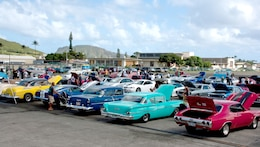 More than 500 classic and custom automobiles line the tarmac at Hangar 101, Marine Corps Base Hawaii during the 2009 Oahu Car Clubs Toy Cruise and Car Show, Saturday, Nov. 28.  This is the 35th year of the cruise for these clubs; this year's event included a first-ever 'drive and shine' car show.  Participants donated more than 1,000 toys to the Marine Corps' annual Toys for Tots collection effort.