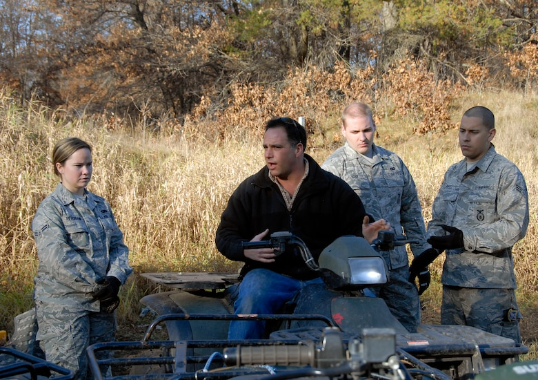 Tech. Sgt. Max Fortin, 115th Fighter Wing Security Forces member and certified All Terrain Vehicle Instructor, explains how to operate an A.T.V to fellow 115th SF Airmen at Volk Field Combat Readiness Training Center Nov. 1, 2009.  115th Fighter Wing Security Forces members are required to know how to operate an A.T.V in various environments. (U.S. Air Force photo by Capt. Suzanne Vanderweyst)