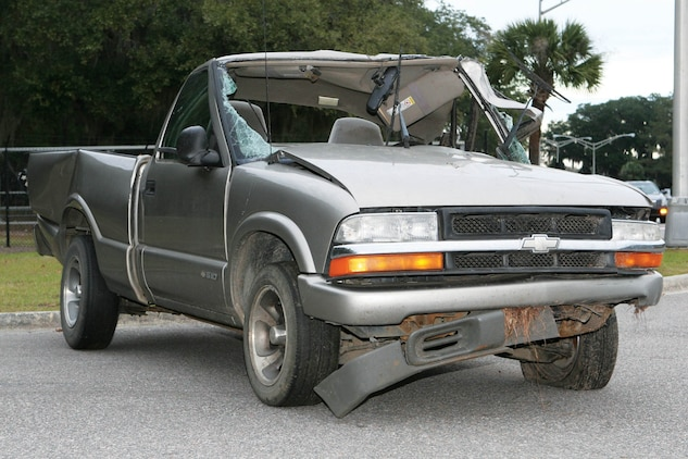 A wrecked Chevrolet S-10 parked near the front gate aboard the Air Station represents the necesity of safety while driving. Plan ahead, have proper safety equipment and avoid all risk when possible to stay safe over the holiday season.