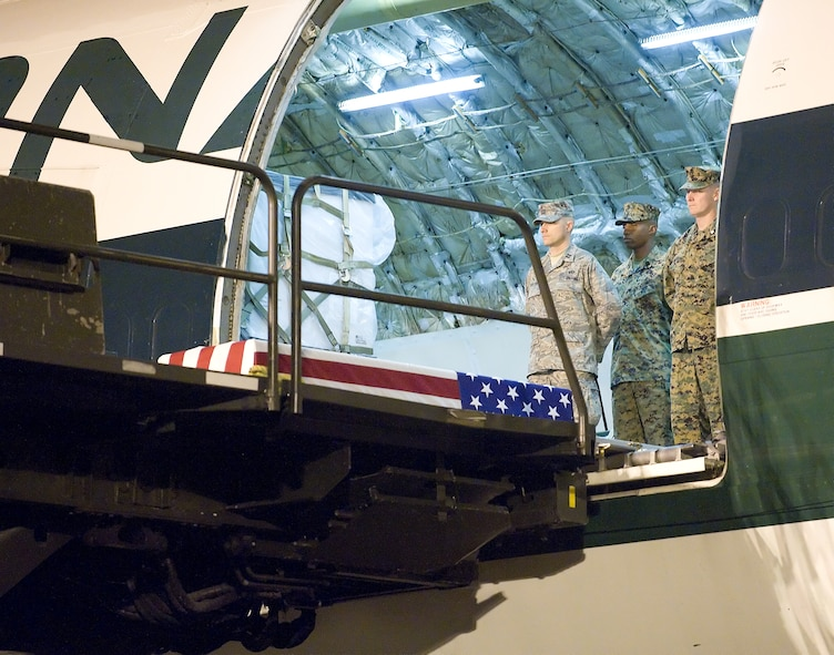 The remains of Lance Cpl. Nicholas J. Hand of Kansas City, MO., await transfer by a  U.S. Marine carry team at Dover Air Force Base, Del., November 24, 2009. Lance Cpl. Hand, 20, died Nov. 22 while supporting combat operations in Helmand province, Afghanistan.  He was assigned to 2nd Battalion, 2nd Marine Regiment, 2nd Marine Division, II Marine Expeditionary Force, Camp Lejeune, N.C. (USAF Photo by Brianne Zimny)
