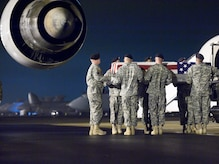 A U.S. Army carry team transfers the remains of Army Specialist Jason A. McLeod of Crystal Lake, Ill., at Dover Air Force Base, Del., Nov. 24, 2009. Specialist McLeod died Nov. 23rd, west of Pashmul, Afghanistan when his unit was attacked with mortar fire. He was assigned to the 704th Brigade Support Battalion, 4th Brigade Combat Team, 4th Infantry Division of Fort Carson, Colo. ( U.S. Air Force photo by Brianne Zimny)
