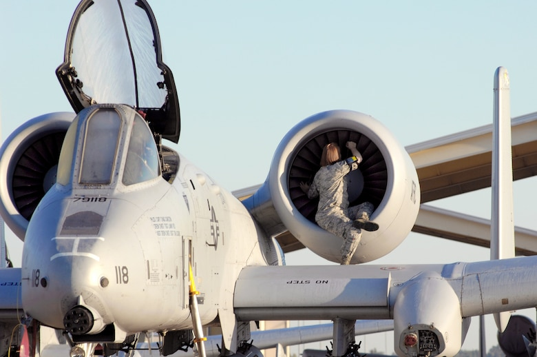 Airman Jill Hallandsworth performs a preflight engine check on an A-10 Thunderbolt II during an overall aircraft inspection Sept. 25, 2009, at Whiteman Air Force Base, Mo. Airman Hallandsworth is a 442nd Fighter Wing crew chief. (U.S. Air Force photo/Senior Airman Kenny Holston)