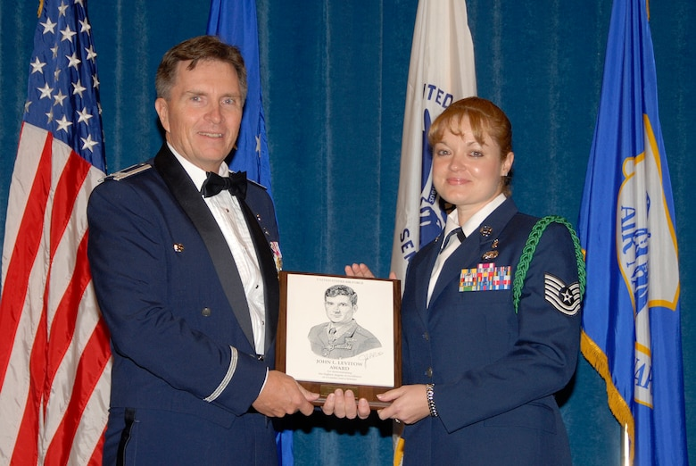 McGHEE TYSON AIR NATIONAL GUARD BASE, Tenn. -- Tech. Sgt. Jennifer M. Pahl, the NCOIC, military health flight of the 49th Medical Operations Squadron at Holloman AFB, N.M., receives the John L. Levitow Honor Award for NCO Academy Class 09-6 at The I.G. Brown Air National Guard Training and Education Center here from Col. Richard B. Howard.  The John L. Levitow Award is the highest honor awarded a graduate of any Air Force enlisted professional military education course.  (U.S. Air Force photo by Master Sgt. Kurt Skoglund)