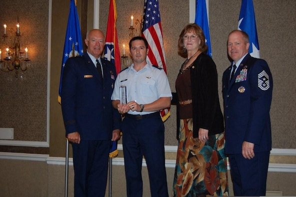 The 129th Rescue Wing was presented the Spaatz Trophy at the 2009 National Guard Association of the United States conference in Nashville, Tenn., Sept. 13. The Spaatz Trophy is named in honor of former Air Force Chief of Staff, Gen. Carl A. Spaatz, and is presented to the overall outstanding flying unit in the Air National Guard. Pictured with the award (from right to left): Gen. Harry M. Wyatt III, director of the Air National Guard, Maj. Michael Wagle, 129th Rescue Wing MC-130P Combat Shadow pilot, Maj. Gen. (retired) Cindy Kirkland, former Nevada Adjutant General and NGAUS vice chair (Air), and Chief Master Sgt. Christopher Muncy, Air National Guard command chief. (Courtesy of the Air National Guard)