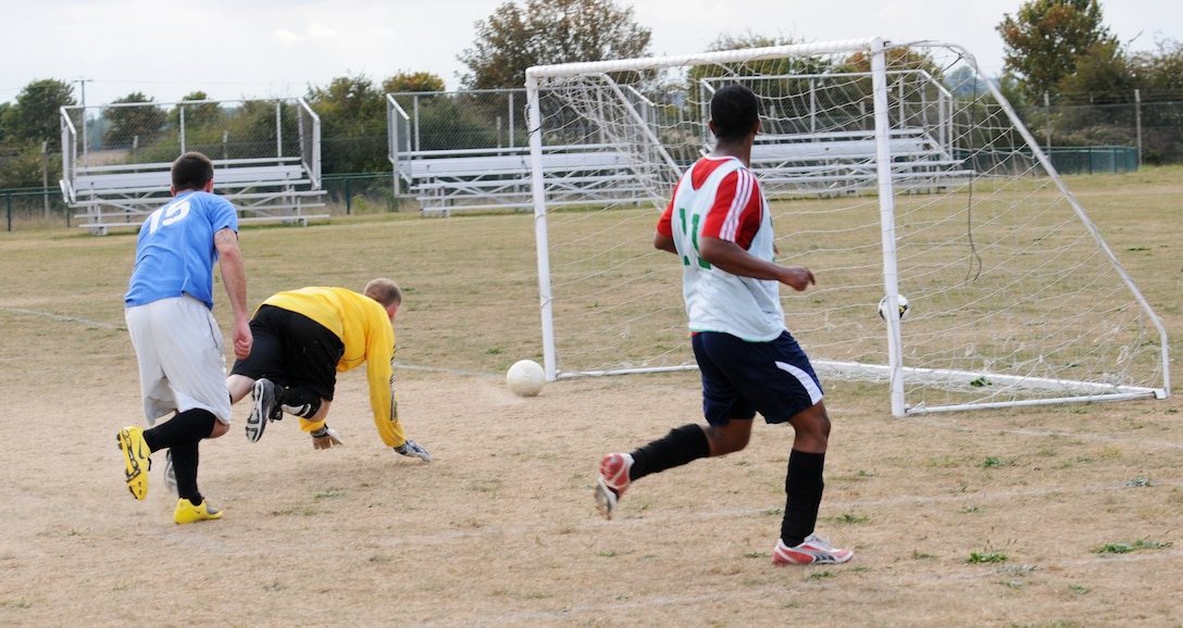 RAF MILDENHALL, England -- Marty Boyl, 94th Reconnaissance Squadron goal keeper, dives to unsuccessfully protect the goal in an intramural soccer match near the Hardstand Fitness Center here Sept. 30. After keeping pace with the 100th Logistics Readiness Squadron in regular play, the combined 488th Intelligence Squadron/95th RS team was unable to keep up in overtime and lost the game 3-6. (U.S. Air Force photo/Senior Airman Thomas Trower)