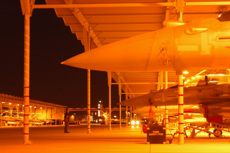 """The 162nd Fighter Wing flightline buzzes with activity during a """"night week"""" when pilots practice flying with night vision goggles. (Air National Guard photo by Maj. Gabe Johnson)"""