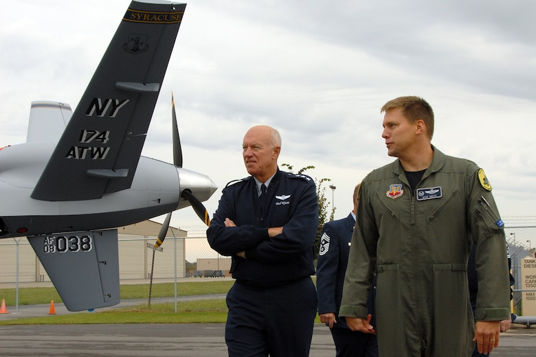 Lt. Gen. Harry M. Wyatt III, Director of the Air National Guard is given a tour of the MQ-9 Reaper on Hancock Field Air National Guard Base on 2 October by Lt. Col. Michael R. Smith, 138th Fighter Squadron Commander. The tour preceded the official ribbon cutting ceremony for the only MQ-9 Reaper Maintenance Field Training Detachment in the U.S. Air Force. (USAF Photo By: SSgt James N. Faso II)