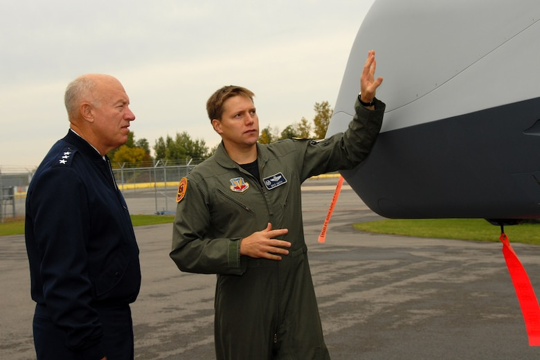Lt. Gen. Harry M. Wyatt III, Director of the Air National Guard is given a tour of the MQ-9 Reaper on Hancock Field Air National Guard Base on 2 October by Lt. Col. Michael R. Smith, 138th Fighter Squadron Commander. The tour preceded the official ribbon cutting ceremony for the only MQ-9 Reaper Maintenance Field Training Detachment in the U.S. Air Force. (USAF Photo By: SSgt. James N. Faso II/RELEASED)