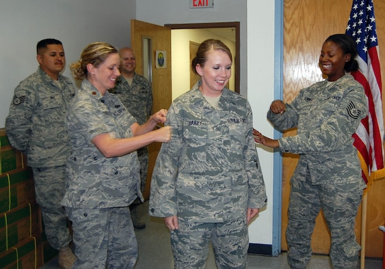 Tech. Sgt. Amy Bailey, 926th Mission Support Squadron (middle), is pinned on by her supervisor, Tech. Sgt. Vickie Sennet (right) and Maj. Dana Sullivan during her Promotion Enhancement Program ceremony here Sept. 30. Sergeant Bailey was the one applicant out of 11 nominated at 10th Air Force to be selected for the early promotion.