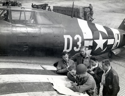 P-47 fighter-bomber pilots at a rough airstrip near St. Mere Eglise on June 15, 1944. By the end of August, all 18 of the 9th Air Force's fighter-bomber and four of its medium bomber groups were based on the continent. (U.S. Air Force photo)