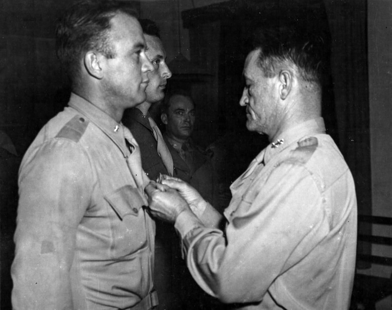 """Brig. Gen. Clinton D. """"Casey"""" Vincent receives an Oak Leaf Cluster to his Air Medal from Maj. Gen. Claire L. Chennault, commander of the 14th Air Force, in December 1944. (U.S. Air Force photo)"""