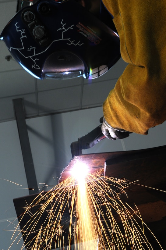 Staff Sgt. Andrew Davis, 39th Maintenance Squadron fabrications shop assistant chief, uses a plasma-cutter to slice through a piece of steel Tuesday, Sept. 29, 2009 at the Incirlik Air Base fabrications shop. Plasma-cutters work by sending a pressurized gas, such as nitrogen, argon or oxygen, through a small channel creating a spark that reduces metal to molten slag. (U.S. Air Force photo/Senior Airman Erica Picariello)