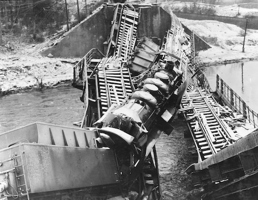 9th Air Force fighter-bombers caught this train trying to cross the Moselle River and destroyed both it and the bridge it was on. (U.S. Air Force photo)