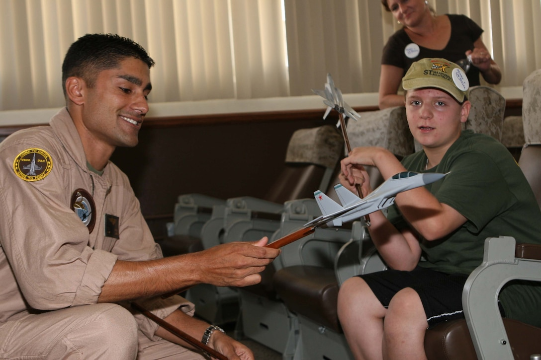 Capt. Taj Sareen, a Marine Fighter Attack Squadron 323 F/A-18 pilot, shows Jared Hyams the model fighter jets pilots use during briefs. The Make-A-Wish foundation granted Hyams his wish to attend the 2009 Marine Corps Air Station Miramar Air Show Oct. 1st.