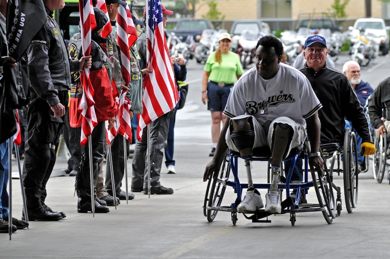 Athletes participating in the 29th National Veterans Wheelchair Games (NVWG) are greeted by the Washington Patriot Guard in preparation for the game's opening ceremony. First held in 1981, the even has grown to include more than 500 athletes competing in 17 different events. The games are being held here in Spokane, WA from the 13 - 18th of July, 2009. (U.S. Air Force photo by Staff Sgt Anthony Ennamorato)