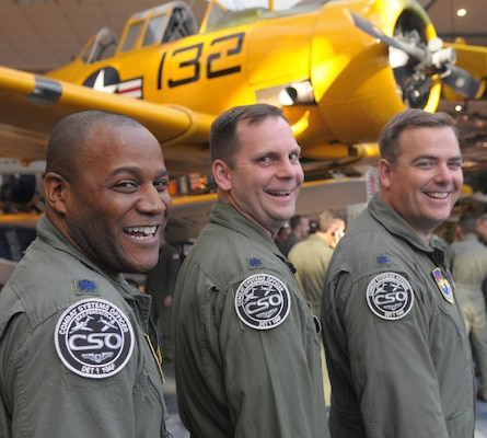 The three squadron commanders of the 479th Flying Training Group stand together Oct. 1 in the National Museum of Naval Aviation at NAS Pensacola, Fla. They are (left to right) Lt. Col. Mike Love, 455th Flying Training Squadron, Lt. Col. Ray Chuvala, 479th Operations Support Squadron, and Lt. Col. Jeff Burdett, 451st Flying Training Squadron. (U.S. Air Force photo by Joel Martinez)