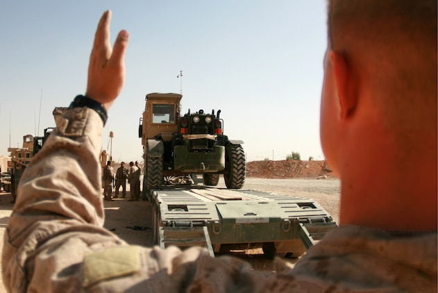 Lance Cpl. Nicholas L. Hornborg, a heavy equipment operator with 4th Platoon, Transportation Support Company, Combat Logistics Battalion 46, guides a forklift off of a truck during a resupply and retrograde mission at Trebil, Iraq, Oct. 4, 2009.  The platoon has been conducting resupply and retrograde missions out of Camp Korean Village, Iraq, since taking over for CLB-7 in early September.