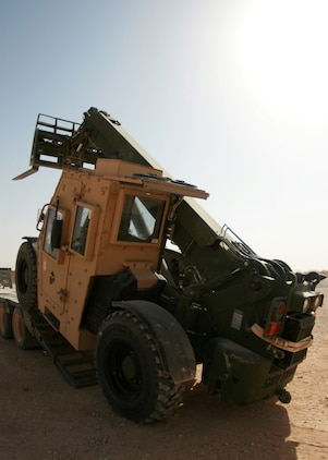 Cpl. Matthew A. Hickman, an engineer equipment operator with 4th Platoon, Transportation Support Company, Combat Logistics Battalion 46, backs a forklift off of a truck during a resupply and retrograde mission at Trebil, Iraq, Oct. 4, 2009.  The platoon has been conducting resupply and retrograde missions out of Camp Korean Village, Iraq, since taking over for CLB-7 in early September.