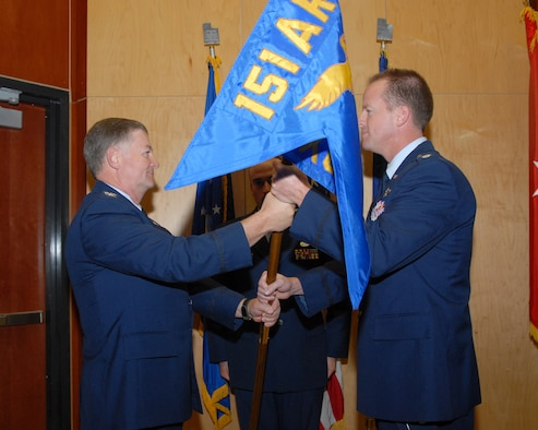 Lt. Col. Nate Nelson accepts command of the 151st Maintenance Group from Col. Kelvin Findlay, 151st Air Refueling Wing commander, during a change of command ceremony held on October 4 at the Utah Air National Guard base.  Change of command ceremonies are a time-honored tradition symbolizing the continuity of authority as the command is passed from one individual to another.  Col. Ron Blunck is the outgoing commander. U.S. Air Force photo by Staff Sgt. Emily Monson.