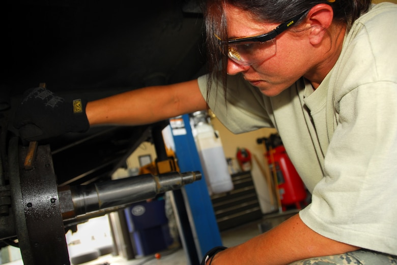 Senior Airman Teri Diemel, a munitions system apprentice with the 115th Fighter Wing, Madison, Wis. performs routine servicing on a munitions trailer.