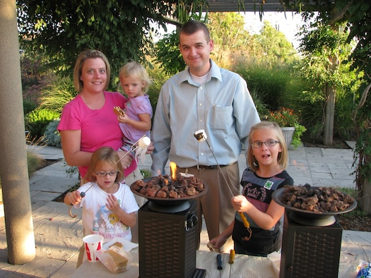 KAYSVILLE, Utah  Utah Air National Guard's 1st Lt. Kevin Loveridge and wife Shikay roast s'mores at the Utah House during a recent Speak Out For Military Kids event in September.  Their daughters Kenedy, Gracie and Molly were able to participate in a variety of activities, from bird watching to generating electricity, during the military family event. Photo courtesy of Debbie Ramsay.
